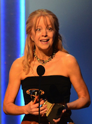 Maria Schneider accepts her Grammy Award on Sunday Photo by Frederic J. Brown/AFP