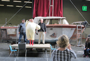 Against a boat on dry land, soprano Rachel Schutz as Thérèse/Tirésias at the Opera Parallèle rehearsal; busy supers behind her are Michael Strickland and Michael Harvey Photos by Janos Gereben