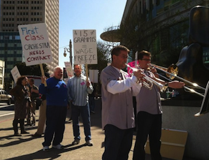 Striking musicians Mark Inouye and Tim Higgins lead the march