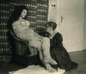 Hermine Moos posing with the Alma Mahler doll