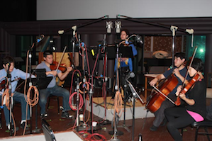 Ann Moss (center) with the Hausmann Quartet, on the sound stage at Skywalker Ranch. Photo by Jeff Kaliss