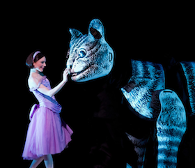 Sarah Lamb (Alice) and the Cheshire Cat in the Royal Ballet production of <em>Alice's Adventures in Wonderland</em> Photos by Johan Persson