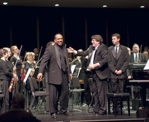 Maestro Asher Raboy, shown above on stage with pianist Leon Bates, left, conducts his final concert as music director of the Napa Valley Symphony on May 16, 2010.