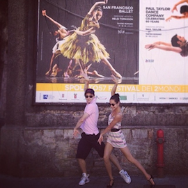Principal dancers Mathilde Froustey and Pascal Molat pose in front of a Spoleto Festival poster advertising S.F. Ballet