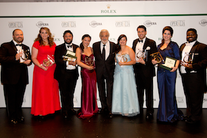 Left to right: Andrey Nemzer, Rachel Willis-Sorensen, Mario Chang, Mariangela Sicilia, Placido Domingo, Anais Constans, Joshua Guerrero, Amanda Woodbury, John Holiday. Photo: Craig Mathew / LA Opera