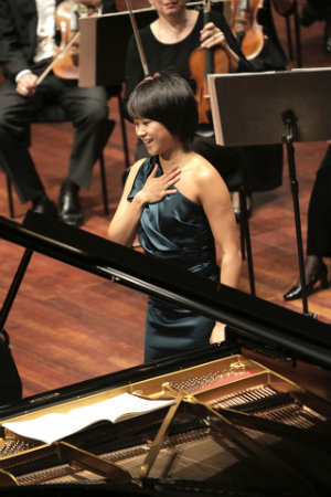 Yuja Wang receives applause in Edinburgh; there and in London, she was featured in the Beethoven Piano Concerto No. 4 and Bartok's Piano Concerto No. 2