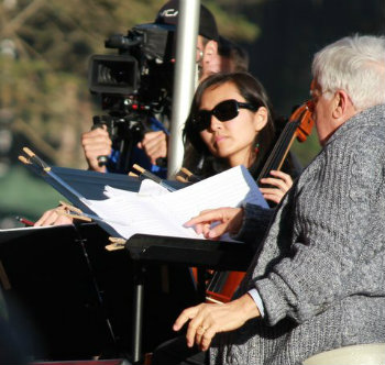 Kronos Quartet cellist Sunny Yang, with Van Dyke Parks, at the Hardly Strictly Bluegrass Festival (Photo by Jeff Kaliss)