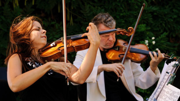 Simin Ganatra, first violin, and Sibbi Bernhardsson, second violin, of the Pacifica Quartet performing for Music in the Vineyards