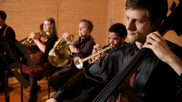 The brass and bass of Elevate Ensemble performing. (Photo by Michael Tebow)